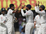 Indian players celebrate the wicket of New Zealand's cricket captain Kane Williamson during the fourth day of the third test cricket match between India and ...