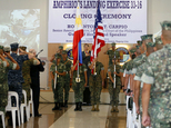 U.S. Marines from the 3rd Marine Expeditionary Brigade and their Philippine counterpart salute at the closing ceremony of the 33rd joint US-Philippines amphi...