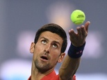 World number one Novak Djokovic serves against Fabio Fognini of Italy at the Shanghai Masters on October 11, 2016