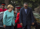 German Chancellor Angela Merkel, left, is welcomed by Ethiopia's Prime Minister Hailemariam Desalegn, as she arrives at the national palace in Addis Ababa, E...