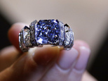 A model shows 'The Sky Blue Diamond' ring at the auction house Sotheby's in London, Tuesday, Oct. 11, 2016. The mesmerizing and rare vivid blue diamond weigh...