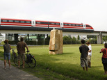 FILE- In this Friday, Aug. 1, 2008 file photo, people watch the then new Transrapid train TR09 on the tracks of the magnetic highspeed train test course in L...