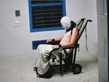 Frame grab from Australian Broadcasting Corporation footage aired in July 2016 shows a teenage boy hooded and strapped into a chair at a youth detention cent...
