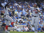 Washington Nationals' Jayson Werth, left, celebrates after his home run with Bryce Harper during the ninth inning in Game 3 of baseball's National League Div...