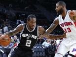 San Antonio Spurs forward Kawhi Leonard (2) drives on Detroit Pistons forward Marcus Morris (13) in the first half of a preseason NBA basketball game in Aubu...