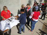Chicago Teachers Union members pick up strike material outside union's strike headquarters Monday, Oct. 10, 2016, in Chicago. Negotiators for the union and C...
