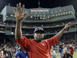 Boston Red Sox's David Ortiz waves from the field at Fenway Park after Game 3 of baseball's American League Division Series against the Cleveland Indians, Mo...