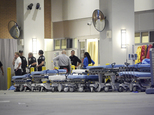 FILE - In this June 12, 2016, file photo,emergency personnel wait with stretchers at the emergency entrance to Orlando Regional Medical Center hospital for t...