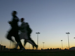 FILE - In this Thursday, Jan. 22, 2004 file photo, students jog around a stadium at sunset in Bowling Green, Ky. A large, international study released on Mon...
