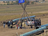 Law enforcement officers, left, drag a person from a protest against the Dakota Access Pipeline, near the town of St. Anthony in rural Morton County, N.D., M...