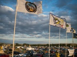 Flags of Native American tribes from across the US and Canada line the entrance to a encampment near Cannon Ball, North Dakota in protest against the Dakota ...