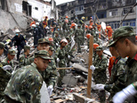 Rescuers clear the debris to search for victims on the site of collapsed residential buildings in Wenzhou city in east China's Zhejiang province, Monday, Oct...