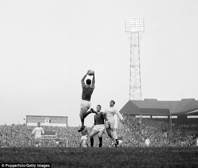 Dunne claims the ball for United at Old Trafford in a Fairs Cup game against Strasbourg