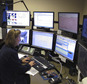 In this Thursday, Oct. 6, 2016 photo, dispatcher Kelly Orsini works at her communications desk at the police department in Naugatuck, Conn. While many police departments around the country are concealing their dispatch communications through encryption, Naugatuck, among others, has decided to keep theirs open to the public. Some police chiefs have said their officers may not be able to communicate on encrypted systems with first-responders in neighboring towns. (AP Photo/Dave Collins)