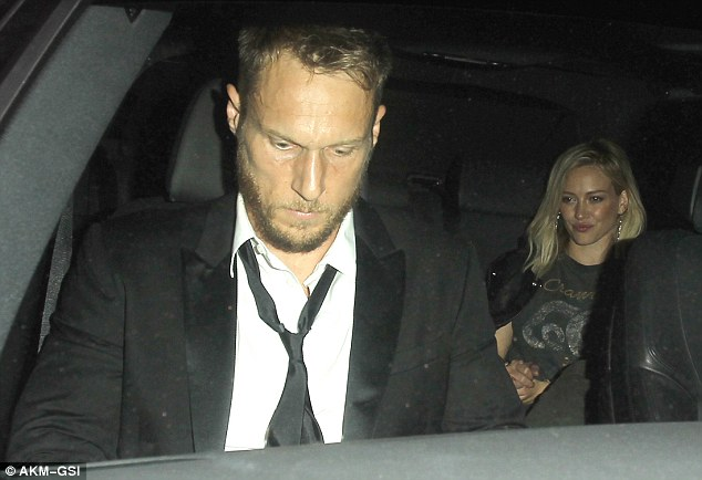 Keeping a low profile: Celebrity personal trainer Jason Walsh kept his head down as he jumped into the front passenger seat of a car with Hilary Duff after leaving Hollywood club Warwick separately on Friday evening