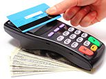 Hand of woman paying with contactless credit card with NFC technology, credit card reader, payment terminal.