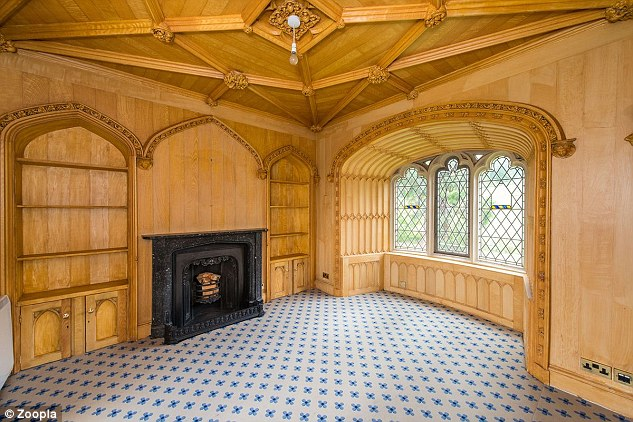 The interior includes wood panelling, original fireplaces and decorative windows.