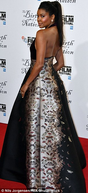 Butterflies: The actress showed off her figure in the gown which featured a butterfly design
