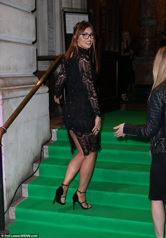 Oops! Ferne McCann proved even a red carpet expert can suffer an embarrassing incident after her racy lace up dress unravelled at the Specsavers' Spectacle Wearer of the Year Awards at London's 8 Northumberland Avenue on Tuesday