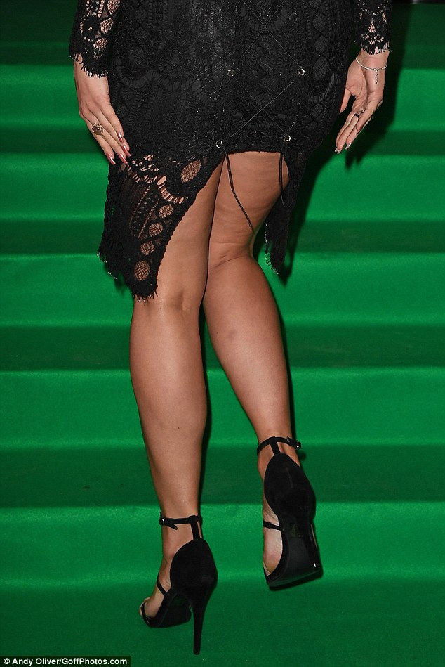 Oh dear! The 26-year-old former TOWIE star pulled her very best poses as she arrived at the star-studded bash yet she suffered a wardrobe malfunction when the dress appeared to split