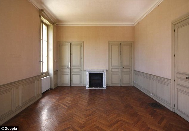 There are three large reception rooms on the ground floor of the chateau, each with a marble fireplace and parquet flooring