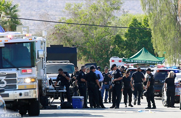 Above police officers from various agencies are shown at their command center on Saturday in Palm Springs