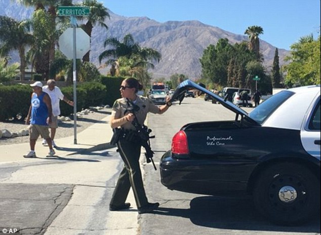 A law enforcement officer joins other emergency personnel in Palm Springs on Saturday