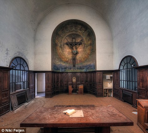 An old chapel dominated by the figure of the crucified Christ in a niche