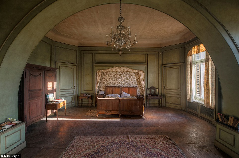 Eerie: This vast bedroom still bears the marks of its previous inhabitants, with white pillows resting on the two single beds joint together