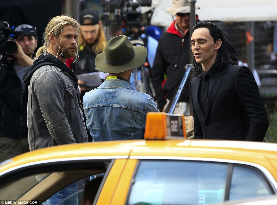 US calling? He was later joined by  Tom (R) on set, where they appeared to be filming a scene in New York with yellow cabs