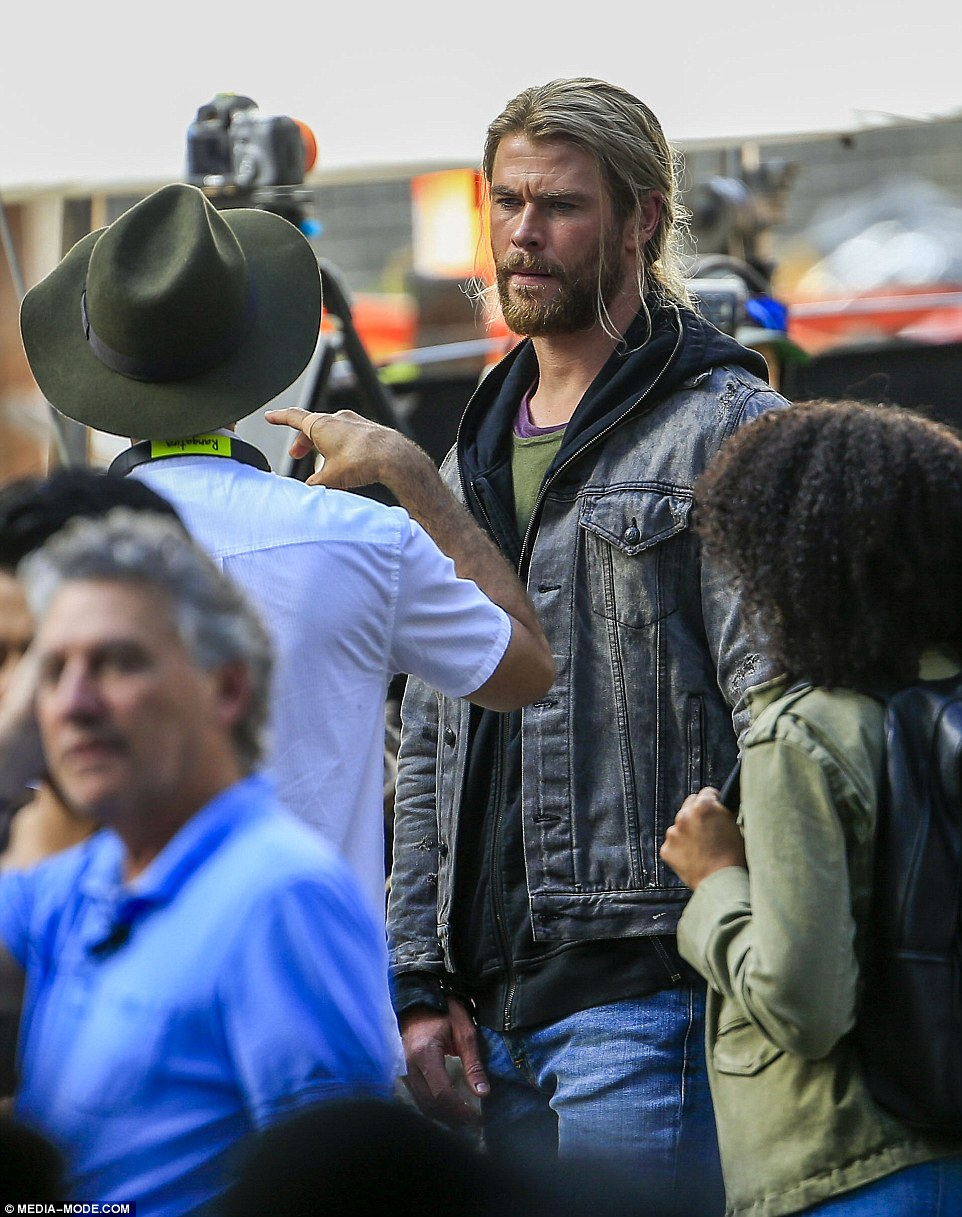 What's up: Chris looked in deep concentration as crew members guided him through scenes during filming