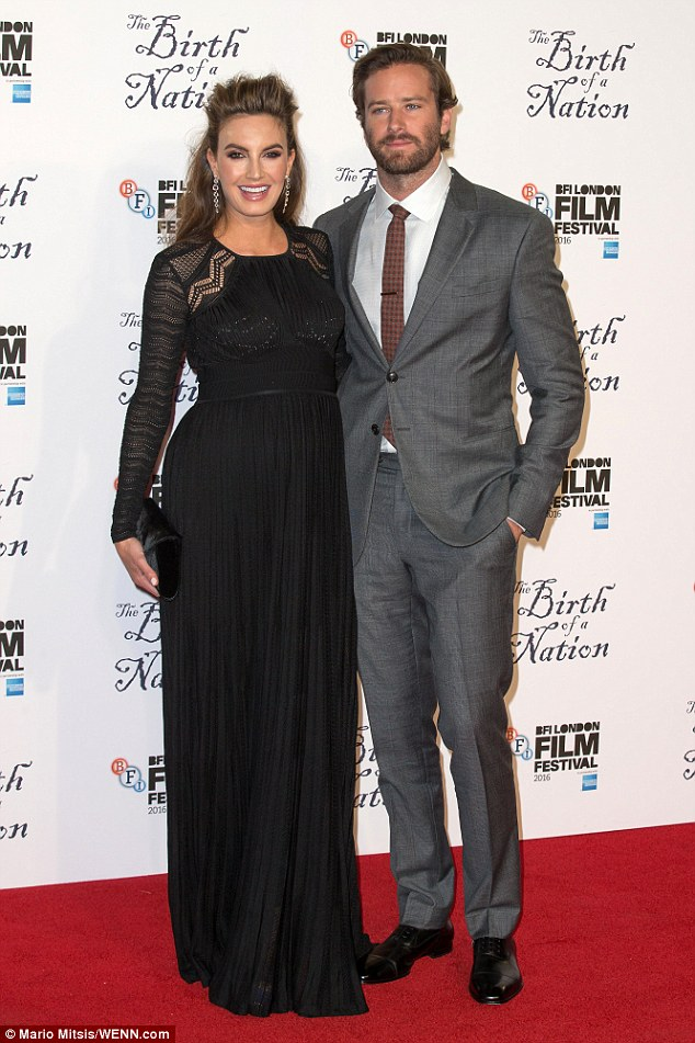 Expecting: Armie brought along his pregnant wifeElizabeth Chambers for the event
