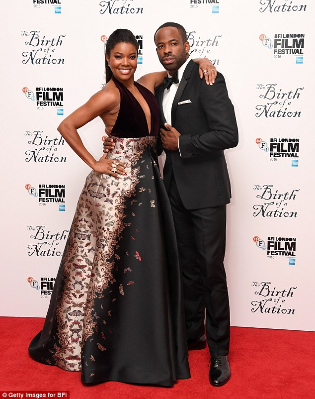 Fancy seeing you here! Gabrielle andChike posed together on the red carpet