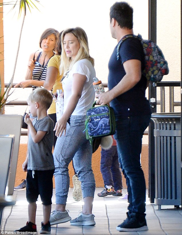 Family fun day:Hilary had a great time with ex Mike Comrie and their son Luca, aged four, in Los Angeles shortly after she received her new tattoo