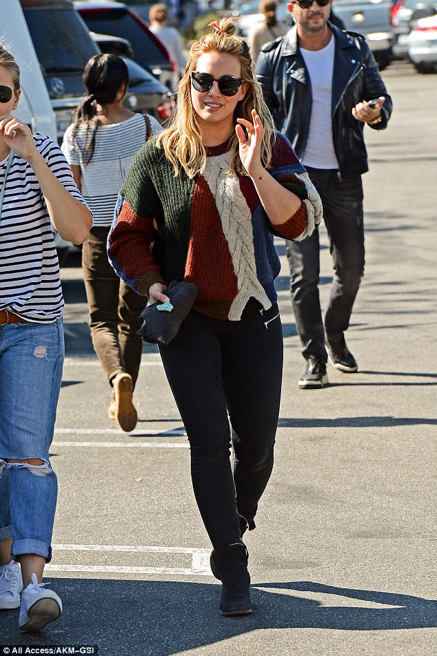 Tatts not all: Later on Tuesday, she was spotted covering her arms as she enjoyed some retail therapy in West Hollywood