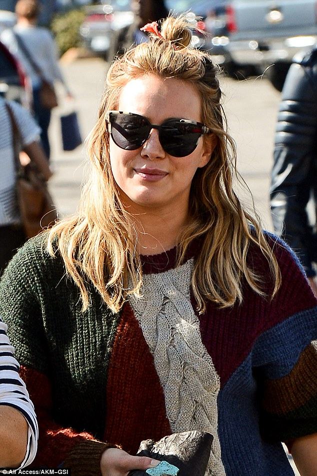 Knit all folks: The star donned a light sweater as she joined a pal at The Grove, in the fall sunshine
