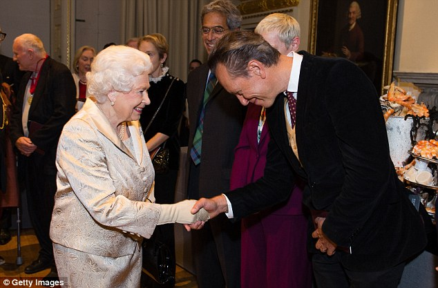 Bow down: Richard E. Grant bowed graciously in front of her as the pair shook hands