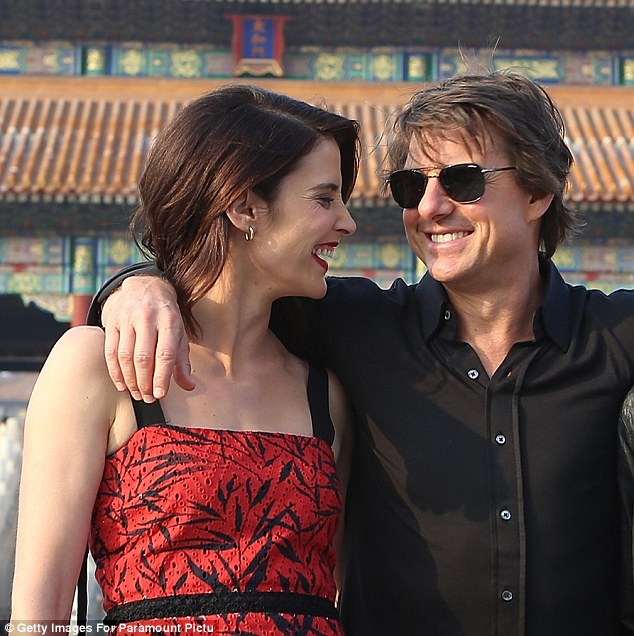 Getting along famously: Tom and co-star Cobie shared a joke and a laugh as they posed for photos
