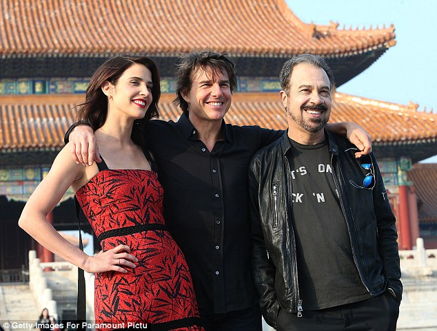 Say cheese! The pair were joined by the film's director Ed Zwick, who also worked with Tom on his 2003 film The Last Samurai