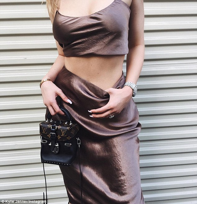 Top of the crops! Jenner flashed her toned tum in a satin crop top and high waist skirt