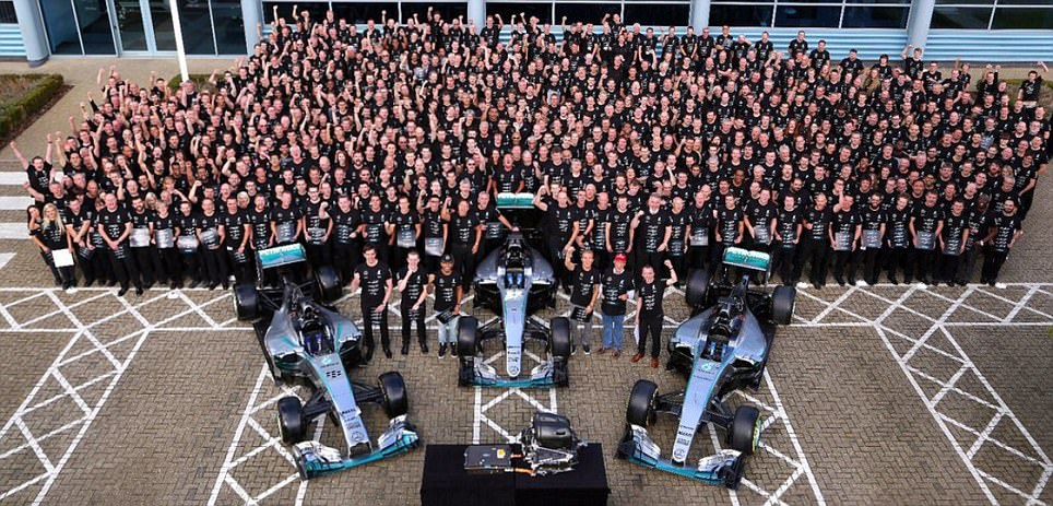 Lewis Hamilton celebrates with his huge Mercedes 'family' after third straight