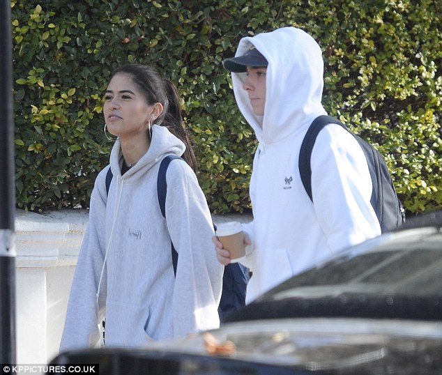 Out and about: model Kim Turnbull enjoyed a stroll with Guy Ritchie and Madonna's son, Rocco in London on Monday- after being pictured out with mutual pal Brooklyn Beckham