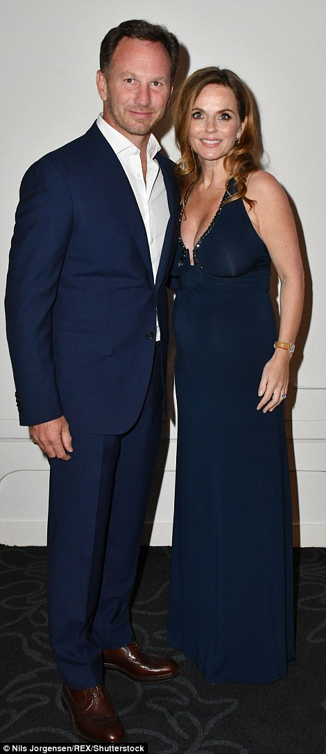 Bumpy ride: The 44-year-old former Spice Girl wowed in a navy halterneck dress which showed off her growing bump which had already formed an impressive size
