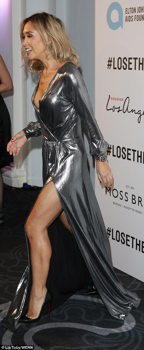 Silver sensation: Myleene Klass was determined to put herself at the forefront of the chic arrivals as she dazzled in a plunging silver gown at the Attitude Awards