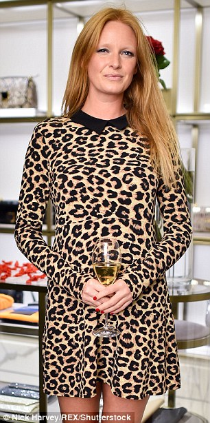 Olivia Inge showcased her unique style in a leopard print dress as she enjoyed a glass of wine