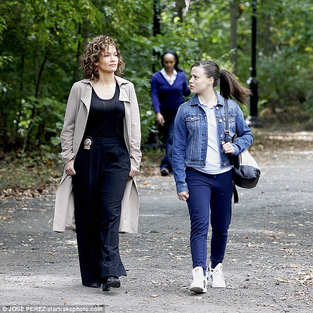 Cop style:Jennifer wore her usual beige trench coat and black slacks to play tough NYC cop Harlee Santos