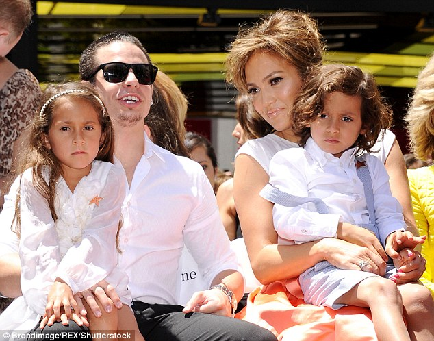 They're over: The 47-year-old beauty is not longer dating Casper Smart; here they are pictured in 2013 with Max and Emme