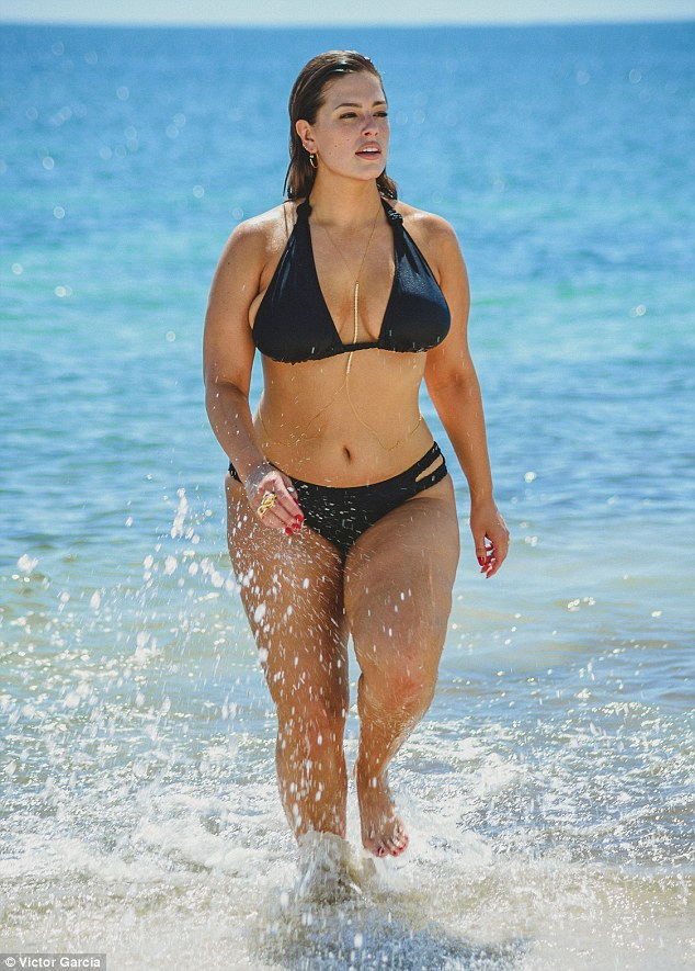 Bikini babe: Ashley Graham had a Bond girl moment as she cooled off in the ocean in Cancun last week