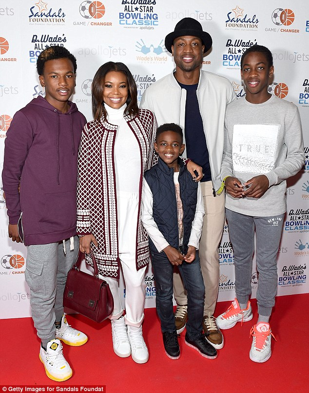 Happy family: Dwyane's nephew Dahveon Morris, Gabrielle, son Zion Wade, Dwyane and Zaire - pictured from left to right - at Wade's charity bowling event in Toronto back in February