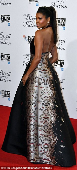Gorgeous: She stunned in the gown with featured a velvet halterneck detail showing off the actress's toned back and arms